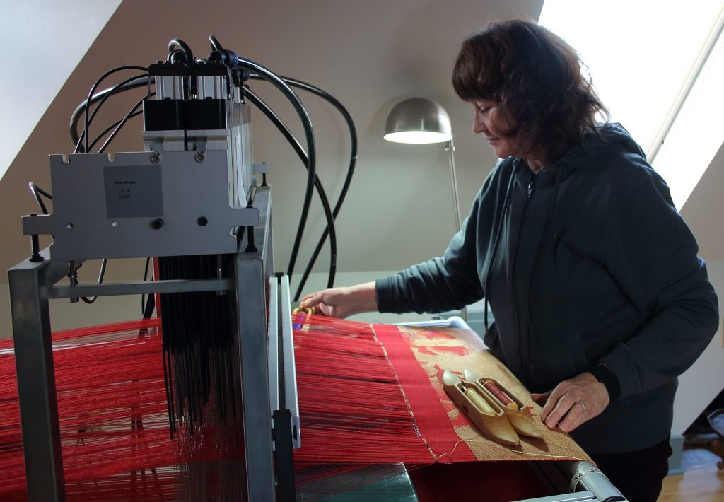 Paulette weaving tapestry on TC1 loom. Photo by Bhakti Ziek
